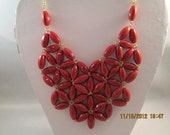 Bib Necklace with Maroon Color Flowers and Gold Centers on a Gold Tone Chain