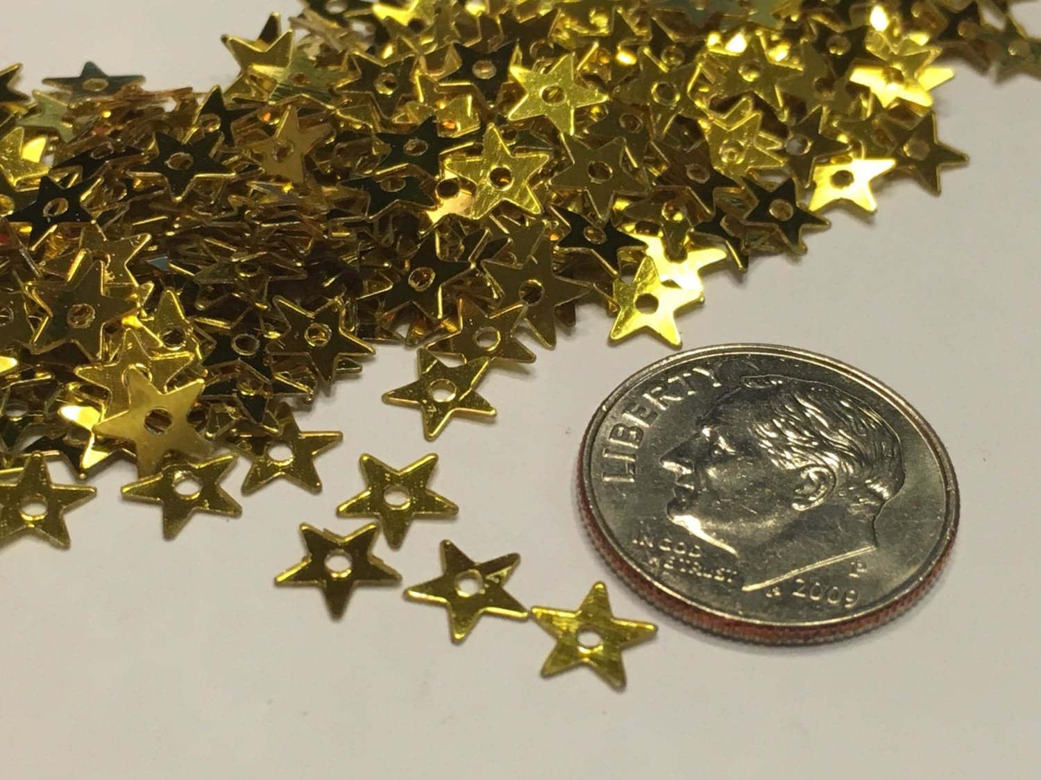 Piece gold color point small tiny star sequins