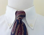 Vintage 1960s / 1970s Brooks Brothers MAKERS All Silk Multi-Colored Paisleys on Navy Blue Trad / Ivy League Neck Tie.  Printed in England.
