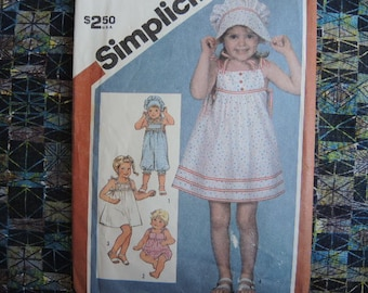 vintage 1980s Simplicity sewing pattern 5954 toddlers pull on romper in two lengths pullover dress and hat size 3 uncut