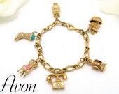 Vintage AVON Charm Bracelet 1973 With Six (6) Charms