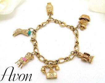 Vintage AVON Charm Bracelet 1973 With Six (6) Charms