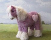 Lilac shire horse with curly mane and tail