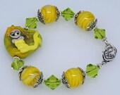 MERLENE MERMAID:  Artist Lampwork Glass Heart Bracelet Peridot Green and Yellow