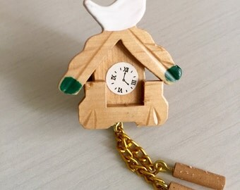 Miniature cuckoo clock brooch.