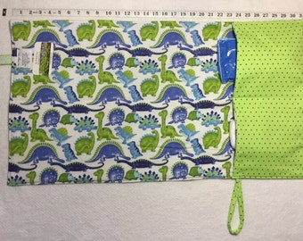 flip and go travel diaper changing pad/baby changing pad/travel diaper clutch with pockets - blue and lime green dinosaurs with green dots