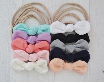 FLASH SALE- set of 10 knot bows on nylon headbands, one size fits all nylon headband, baby hair bow, newborn headband, toddler headband