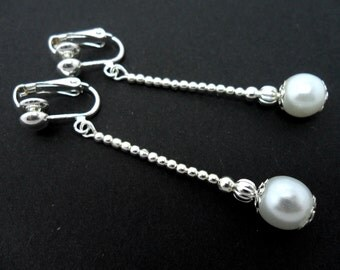 A pair of pretty white glass pearl bead  dangly clip on earrings.