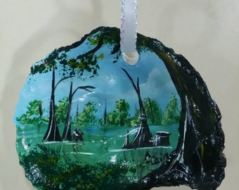 Hand painted  oyster shell ornament featuring a bayou scene