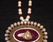 Red egg shaped pendant with zircons and kundan, oval, red and pearl string