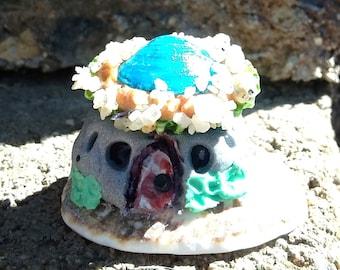 Tiny sand dollar sea shell fairy hut sand castle