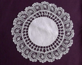 Crochet doily, vintage.  A very pretty round doily with a linen centre, crochet border in a beautiful design.  c 1910-s to 50's.