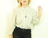 chevron blouse . secretary blouse zebra blouse . cream blouse .