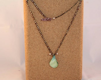 Pink and green necklace with green pearl pendant