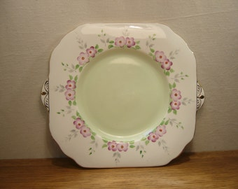 Vintage 1950s Thomas Forester & Sons Phoenix bone china tab handle cake plate or bread and butter plate hand painted with pink flowers