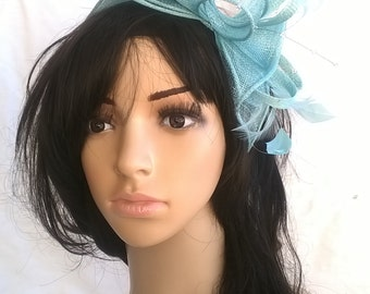 Aqua rosette fascinator ..on a headband  ..Stunning for races ,wedding..black feathers
