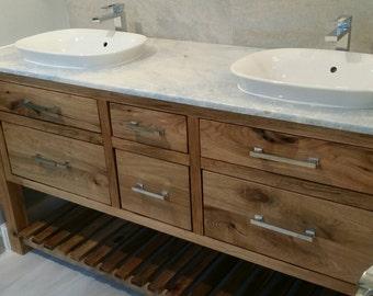 White walnut vanity with granite top and semi-recessed vessel sinks.