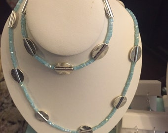 Glass and metal bead set. Three pieces.