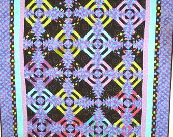 Quilted wall hanging or lap quilt. Machine pieced pineapple pattern