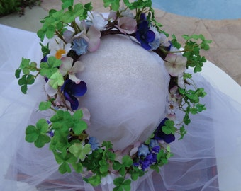 Flower girl hair crown designed in a mixed garden look