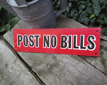 Metal Post No Bills Sign. Red Sign with Black Letters. 4 Holes for Hanging. Nice Condition.