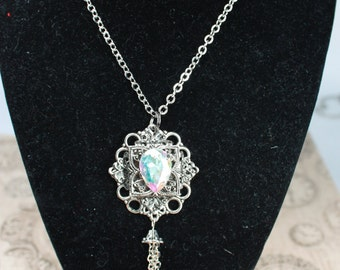 long necklace with glass cabochon and tassels