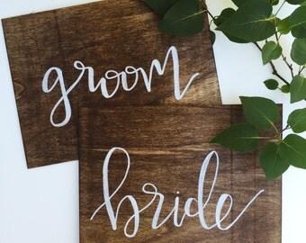 Bride/groom wooden signs (set of 2)