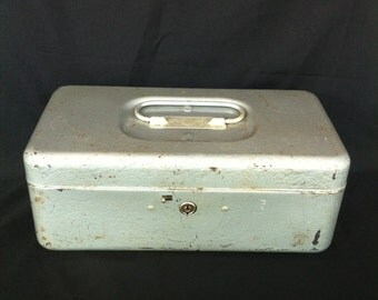 A Rusty Crusty Light Grey Metal Box Marked CCC TOP Products