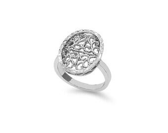 Sterling Silver oval diamond cut fancy ring.