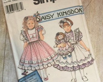 Daisy Kingdom Pinafore, Dress, and Doll pattern simplicity 8877 uncut size 5, 6, 6x