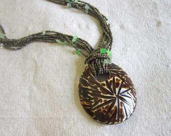 Striped Horn Medallion-Metallic and Green Rock Bead Strand-African-Dark Brown