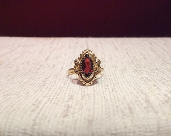 Marquise cut garnet ring 14k gold