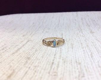 Bezel set firestone opal ring
