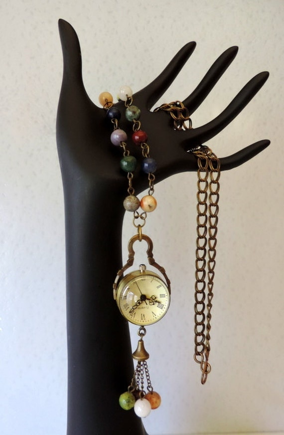Antique bronze, multigemstone, watch locket necklace.