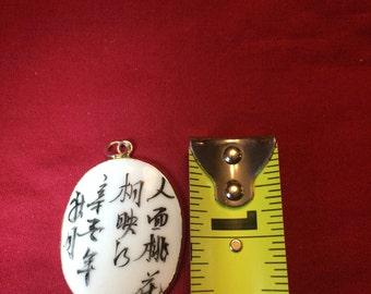 Hand painted porcelin pendant