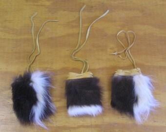 3 Skunk Fur & Gold Deer Leather Bags