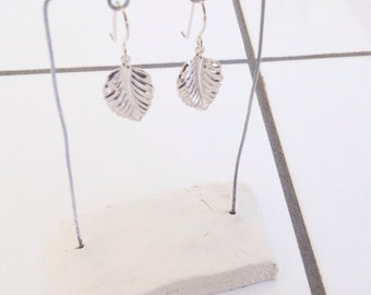 Silver earrings with a leaf
