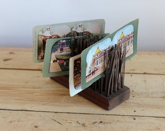 The Holmes Stereoscope. Engraving on meta with a wooden handle.With7 cards for stereosope.