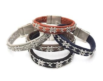 Scandinavian Sami reindeer leather bracelets; Snowflake design