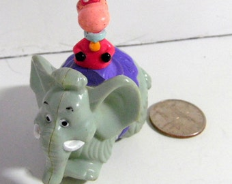 1990  rolling Dino, Flintstones toy.  Hanna Barbara, Fast food toy.  26 years old