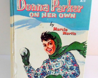 Donna Parker on her own by Marcia Martin.  It is dated 1957 by Whitman's publishing