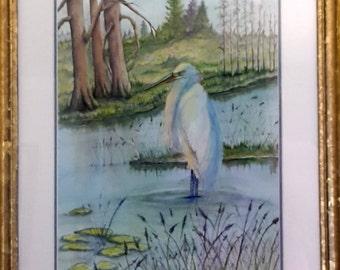 Heron i a pond with Lilies