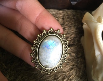 One brooch with moonstone. Brass materials