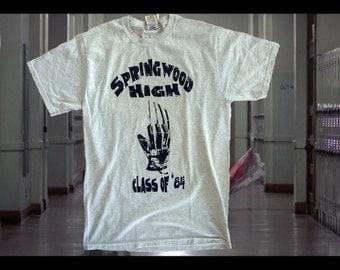 A Nightmare on Elm Street 1984 Freddy Krueger glove tshirt Classic one color distressed Tshirt. Screen Printed horro movie t-shirt