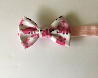 Pink piggy bow headband