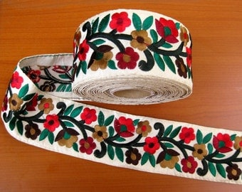 9 meters. Border, lace,  embroidered floral design in multi colors. white border border. (355 inches approx.).