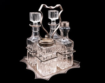 Vintage Cruet Set with Silver Plated Holder and 4 Glass Bottles