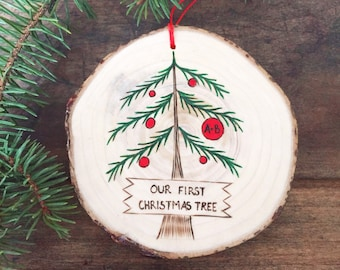 Wood burned and painted Our first Christmas tree ornament made from your own Christmas tree wood slice