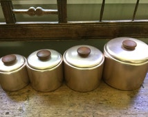 Vintage mid century modern canister set of four aluminum copper tint canisters teak wood knob handle