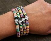 Hematite Skull and African Trade Bead Layering Bracelet. Colorful African Vinyl Disc Bead Stretch Bracelet. Boho Stacking Bracelet.